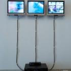 Elizabeth Milton and Sheila Poznikoff, <em>St. Theresa's Basement</em>, three-channel video, 2010,  installation view