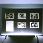 Eric Baudelaire, <em>The Makes (Out of Desperation)</em>. found Japanese film stills, page torn from That Bowling Alley on the Tiber by Michelangelo Antonioni, Plexiglas, steel and fluorescent tubing, 2009