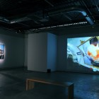 Eric Baudelaire, installation view of <em>Sugar Water</em> (right), <em>Blind Walls (I claim)</em> (left), <em>Unfinished Business</em>, 2010