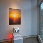 Davida Nemeroff, <em>Escalator – Dallas/Fort Worth Airport</em>, digital video, 2011 and <em>O Clock</em>, poster, 2011, installation view