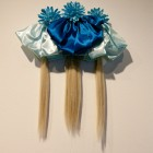 Christine Negus, <em>oh, those sad lonely beasts! (cosmos)</em>, 4 wreaths, 4 falls and 1 braid with artificial hair, ribbon and artificial flowers, 2011-2012