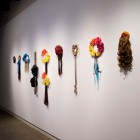 Christine Negus, <em>oh, those sad lonely beasts! (cosmos)</em>, 4 wreaths, 4 falls and 1 braid with artificial hair, ribbon and artificial flowers, 2011-12. Documentation by Morris Lum.