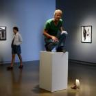 David Levine, <em>Bystanders</em>. Installation view with actor. Documentation: Guntar Kravis, 2015.