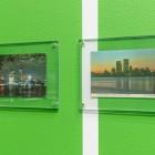 Luis Jacob, <em>Sightlines</em> (detail), 2017. 57 vintage postcards and Chromakey Green mural painting.  Documentation: Toni Hafkenscheid.